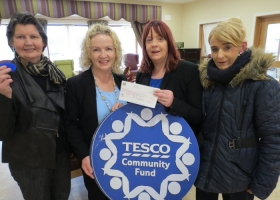 Presentation of cheque for €476.00 from tesco, proceeds of the blue chip community fund